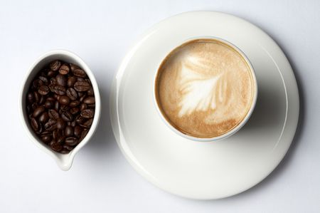 bar ware: barista coffee cup and colombian coffee beans