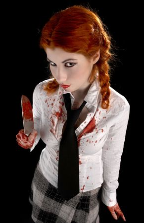 angry schoolgirl with bloody knife over black photo