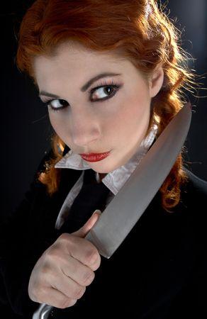 aggressor: portrait of crazy schoolgirl with big knife Stock Photo