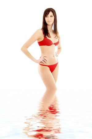 lovely brunette in red bikini standing in water Stock Photo - 735856