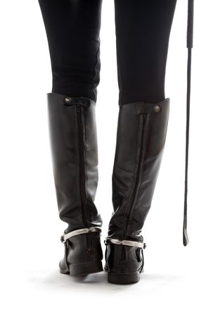 tricot: beautiful legs in black leather horseman boots with riding-crop over white