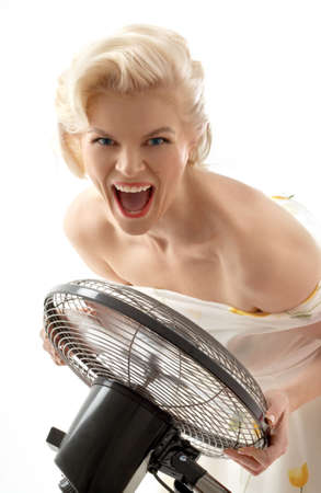 screaming housewife with fan playing pop star photo