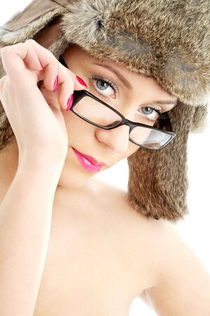 portrait of lovely beauty in winter hat and eyeglasses photo