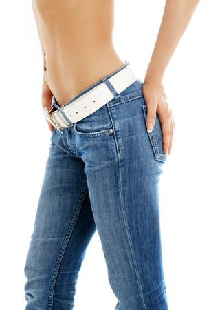topless jeans: closeup of fit lady in blue jeans with white belt Stock Photo