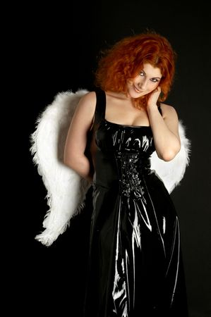redhead in black latex dress with angel wings Stock Photo - 743323