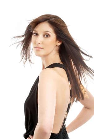 portrait of lovely brunette in motion over white