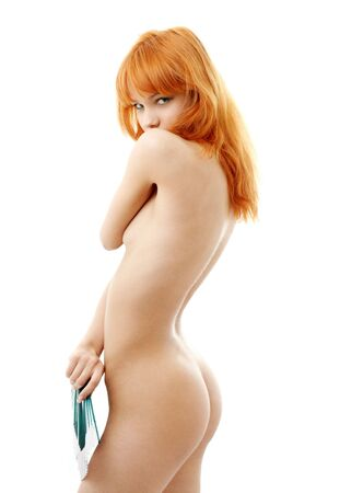 naked redhead with green fan over white