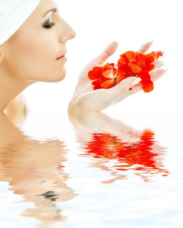 lovely woman with red flower petals in water Stock Photo - 759874