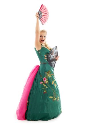 fandango: lady in green dress dancing with fans over white Stock Photo