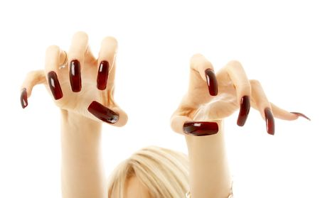 long life: aggressive girl hands with long acrylic nails over white Stock Photo