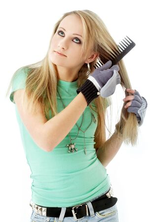 picture of hair combing teenager girl over white photo