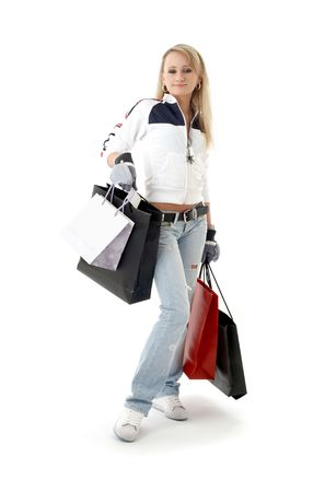 teenage girl with shopping bags over white photo