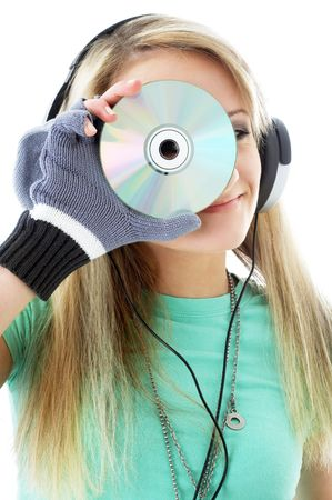 urban teenage girl in headphones holding cd over white photo