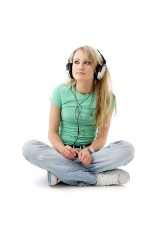 picture of teenage girl in headphones sitting on the floor photo