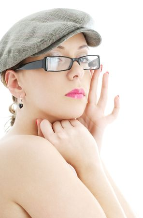 portrait of topless lady in black plastic eyeglasses and cap photo