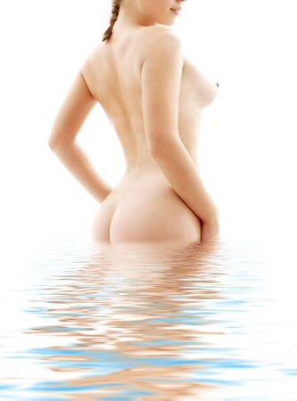 healthy naked woman standing in blue water Stock Photo