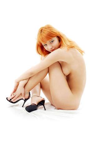 blankes redhead auf hohem Ferse�berschu�wei� Lizenzfreie Bilder