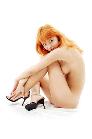 naked redhead on high heels over white