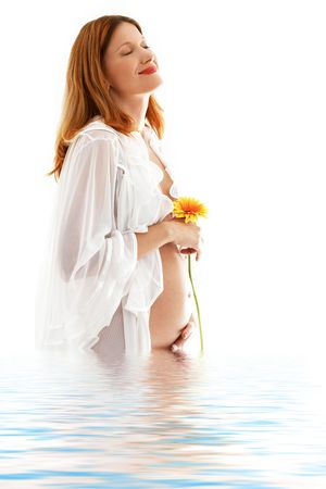 wife of bath: happy pregnant lady with flower in water Stock Photo