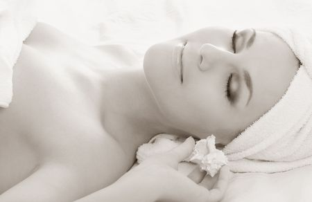 monochrome picture of beautiful lady with sea shell in spa Stock Photo - 804331
