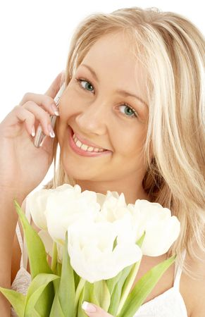 picture of cheerful blond with white tulips and phone Stock Photo - 804335
