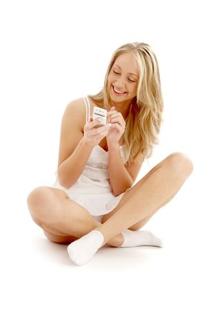 happy teenage girl sitting on the floor with a white phone Stock Photo - 804336
