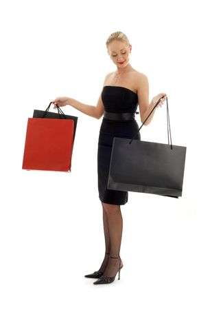 elegant blond with shopping bags over white Stock Photo - 804337