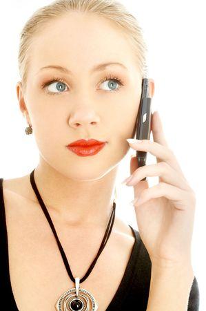 portrait of elegant blond using cellular phone over white photo