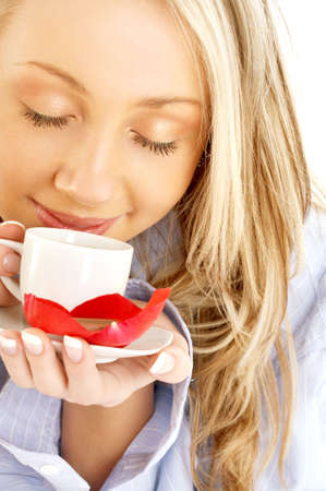 enjoying life: portrait of blond with cup of coffee and chocolate Stock Photo