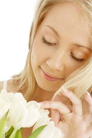 picture of cheerful blond with white tulips photo