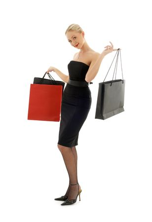 elegant blond with shopping bags over white