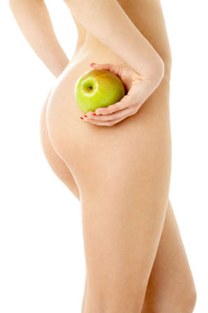 woman with green apple over white