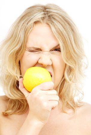 picture of lovely blond biting lemon over white Stock Photo - 831919