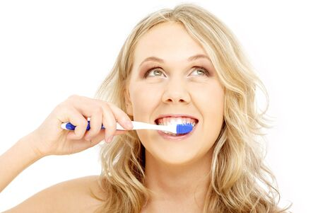 picture of happy blond with toothbrush over white photo