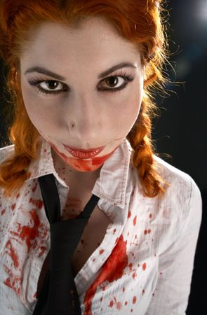 portrait of schoolgirl with blood all over photo