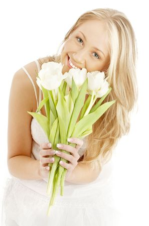 picture of happy blond with white tulips photo