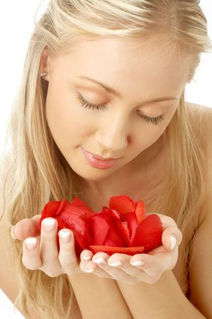 portrait of lovely blond in spa with red rose petals photo