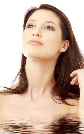 portrait of lovely brunette in water looking up