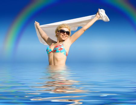 vivifying: picture of happy girl with towel standing in water Stock Photo