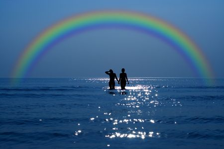 silhouette of two girls holding hands under rainbow Stock Photo - 852637