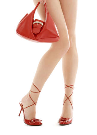 long legs on high heels and red purse over white Stock Photo - 856296