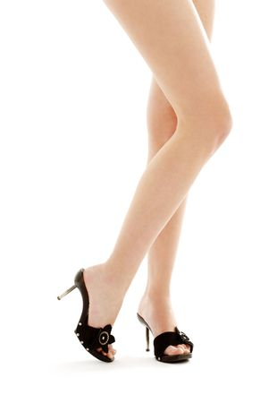 long legs in black kinky shoes over white Stock Photo
