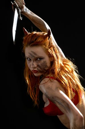 dark red devil girl with a knife over black Stock Photo - 860923