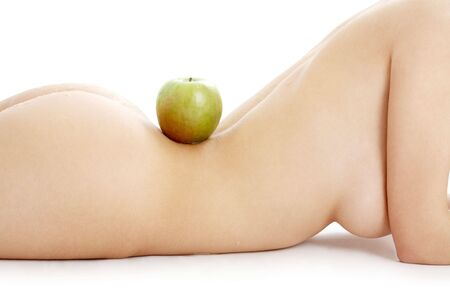 naked woman torso with green apple over white Stock Photo - 877385