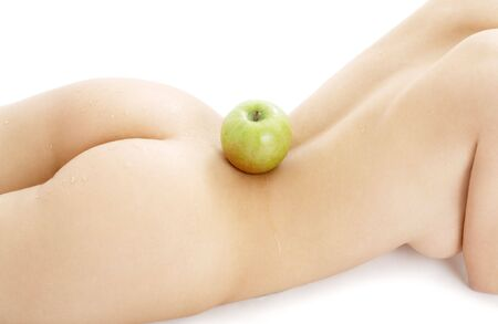 naked woman torso with green apple over white Stock Photo - 877387