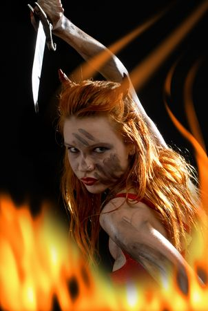dark red devil girl with a knife in fire Stock Photo - 883059