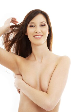 topless brunette: smiling topless brunette with long hair over white