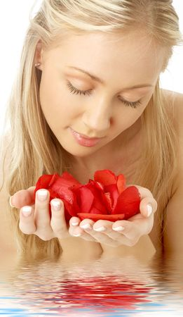 portrait of lovely blond in water with red rose petals Stock Photo - 889410