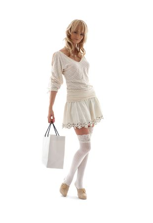 gift spending: gorgeous blond with shopping bag over white Stock Photo