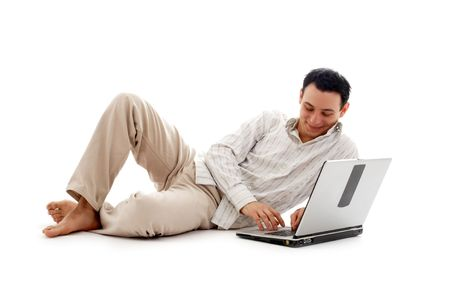 relaxed man with laptop computer over white photo